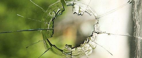Glasschade aan raam